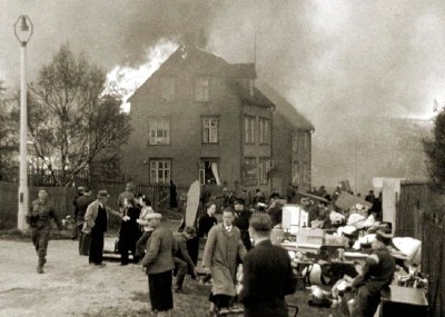 4th July 1940: Houses are burnt to the ground in the Norwegian city of Narvik during the German invasion. (Photo by Fox Photos/Getty Images)